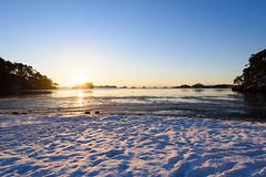Sunrise in Matsushima (kat-taka) Tags: matsushima miyagi japan sea sunshine sunrise snow water morning