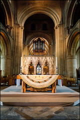 The organ and the altar (G. Postlethwaite esq.) Tags: southwellminster unlimitedphotos altar arches architecture church cloth organ organpipes photoborder pillars plinth