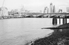 st paul's and the skyline (»alex«) Tags: london riverthames bw blackandwhite blackwhite film scan lomography ladygrey sightseeing cathedral bridge cranes towers