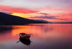 Sunrise in Kastoria (pap-x) Tags: canon nature greece kastoria 550d lanscape wild autumn red fall boat lake sunrise clouds outdoor long exposure