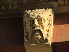 Scroll Face Green Man Gargoyle Above Doorway 4821 (Brechtbug) Tags: scroll face greenman gargoyle above doorway building facade 8th avenue west 21st street nyc 11122018 new york city midtown manhattan 2018 gargoyles portraits monster portrait monsters creature faces spooky art architecture sculpture keystone mask brownstone brown stone capital fall winter autumn creeped out scrolling mustache