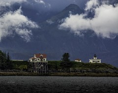 Whale Watching Scenery . . . (Dr. Farnsworth) Tags: lighthouse juneau white rainsnow steep wooded mountains alaska ak whalewatching rain show clouds