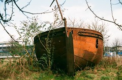 Abandoned Coal Barge, Port Dundas, Glasgow (rockyrutherford) Tags: canoneos1n canonfilm 35mm rusty canal barge scotland glasgow abandoned
