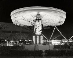 YOYO, Seattle Center, Circa 1978 (fotographis) Tags: seattle seattlecenter night blur amusementride ride lights blackwhite blackandwhite xenotar sinar 4x5 largeformat