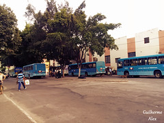 The bus station... (Guilherme Alex) Tags: city cityscape citylife citystreet afternoon hotday bus busstop busy movement pulse citypulse daybyday people world tree green natural sepia nice teófilootoni minasgerais brazil wheels blue street streets buildings central building inthestreet angle composition crossing wood leaves cityview cityculture busstation station parked outside colorful beautiful exploring thecity lovelycity national contrasts landscape cars car happy
