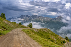Mountain landscape along the road to Colle dell'Assietta (clodio61) Tags: assietta finestre italy piedmont sestriere torino turin cloud color day green landscape mountain nature outdoor photography plant road scenic summer tree