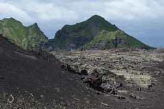 The dragon's lair (bd168) Tags: islande iceland volcan volcano lave lava greenery verdure île island vestmannaeyjar harbour port pêche fishing ocean darkclouds nuages em10markii m14150mmf4056