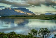 Scotland: The Battle of Sun and Cloud (rocinante11) Tags: scotland coast fujifilm fujireala100 dusk loch