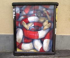 Street art in Paris 20th by Philippe Herard (Sokleine) Tags: mural streetart street rue urbanart artderue arturbain paris france philippeherard armoire bouées red white rouge blanc homme man