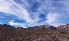 BIG BLUE (Rob Patzke) Tags: rock desert sky blue clouds panasonic lumix lx100 shrub sand mountain stone cactus landscape sagebrush hills strata scenery