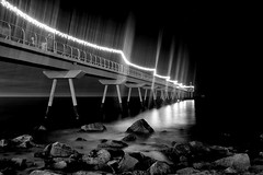 The Pier in Acros R (Fnikos) Tags: sea water mar mare rock bridge puente pont pier decoration chistmas navidad nadal construction sky dark light coast skyline landscape seascape city serene night nightview nightshot bay people boat blackandwhite monochrome outdoor