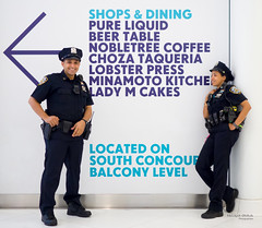 The New Yorkers - Cop blue Chillin' (François Escriva) Tags: street streetphotography us usa nyc ny new york people candid olympus omd photo rue sun light man colors sidewalk blue camaieu shade cops woman cool uniform oculus food fun funny