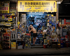 """warming up for another long night"" (hugo poon - one day in my life) Tags: 35mm xt20 hongkong northpoint tinchongstreet statetheatre citynight lights colours vanishing shop warmingup stretching longnight fav"