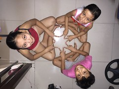 the magic star (ghostgirl_Annver) Tags: asia asian family siblings kids teens circle fingers feet hands