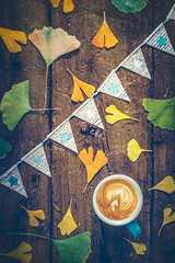 Surprise! (Ro Cafe) Tags: autumn fromabove ginkgoleaves nikkor2470mmf28 nikond600 november odile stilllife topdown autumncolors coffee cupofcoffee flatlay gift paperbuntings tabletop wood nikkor2470f28