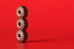 gear balancing (Marc McDermott) Tags: macromondays macromonday balance gears red backgroud macro metal parts teeth three