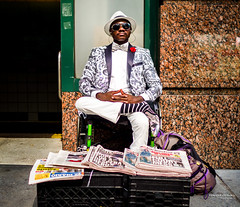 The New Yorkers - King of Newspapers (François Escriva) Tags: street streetphotography us usa nyc ny new york people candid olympus omd photo rue sun light man colors sidewalk wheelchair hat black newspapers sunglasses white smart red green