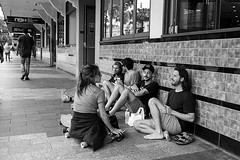 Manly village, Sydney 2018-18  #508 (lynnb's snaps) Tags: apx100 leicacl rodinal wnikkor35cmf18ltm film summer people hotel group sitting smoking manlyvillage newbrightonhotel girl woman boys men rangefinderphotography leicafilmphotography agfaapx100 sydney australia ©copyrightlynnburdekinallrightsreserved ishootfilm