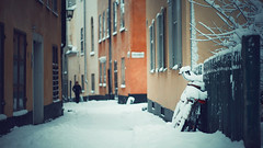 Winter in the old town... (Lorre_1) Tags: oldtownstockholm stockholm snow bike man street winter sweden cold cinematic outdoors canon 50mm europe city
