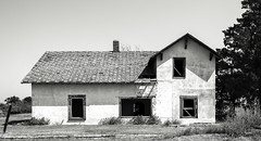Seguin, Kansas (explore) (unknown quantity) Tags: abandonedhouse shadows monochrome sky faded grass trees deterioration brokenroof nowindows blackandwhite weathered htmt