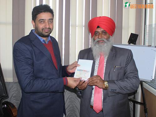 Mr. Gurvinder Kang (Director of West Highlander) handing over Canada Student Visa to Father of Gurbir Singh