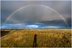 Who's that guy? (Rob Schop) Tags: kwadehoek landscape rainbow weather wideangle goldenhour shadow samyang12mmf20 f8 handheld sonya6000 clouds