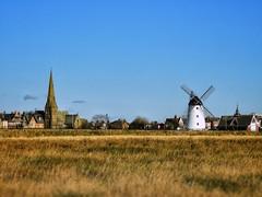 Windmill at Lytham. (Ian, Bucks) Tags: windmill sky grass church spire