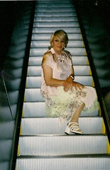 Help! The Power Went Out While I Was On the Escalator, And Now I'm Stuck! (Laurette Victoria) Tags: woman laurette escalator blonde millerpark skirt sandals necklace blouse