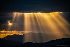 Between the clouds... (german261093) Tags: clouds nubes between sun sol sunset twilight atardecer málaga españa nikon d3000 rayo ray orange naranja
