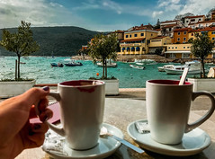 Cups Of Coffee On Wooden Table In Front Of Beach