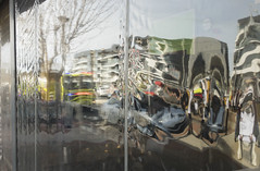 Melting Buildings Cropped (oz_lightning) Tags: act australia canberra macquarie people abstract building cars truck reflections australiancapitalterritory aus