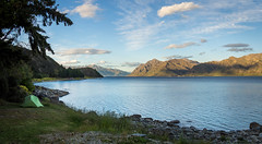 Lake Hawea (loveexploring) Tags: lakehawea newzealand otago southisland southernalps campground camping cloud grass lake lakeshore landscape moon mountains panorama rockyshore sky sunset tent