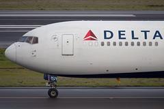 Delta Air Lines Boeing 767-324(ER)(WL) (zfwaviation) Tags: kpdx pdx portland international airport oregon or parking garage airplane aircraft jet plane aviation airliner runways take off landing 10r 10l rain spotting d750 200500mm n394dl delta air lines boeing 767324erwl b767 767300 dl