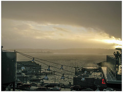 Sunbreak in the Storm (prima seadiva) Tags: market pikeplace rainy weather clouds misty people silhouette