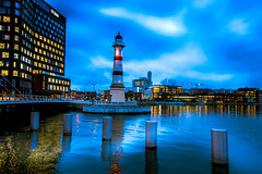 Blue hour (Maria Eklind) Tags: bridge dockan water spegling city cityscape dusk universitetsbron fyr inrehamnen bluehour twilight lighthouse malmö reflection reflectiion sweden skånelän sverige se