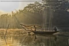 Winter Morning Sunshine. (Halder Ujjwal) Tags: winter morning sunshine river boat fisherman life cold outdoor beautiful bangladesh rajbari faridpur catchingfish nature halderujjwal