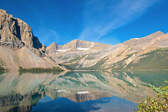 Bow Lake Reflections 2 (Bonsai_Photos) Tags: bowlake nature reflection panorama hill rockies loneliness panoramic alone sky view landscape serene nationalpark water uninhabited outdoor vacation trip travel alberta lonely journey rockymountains idyllic scenery serenity steep forest banff scenic lake canada america tourism lonesome icefieldsparkway