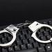 Computer keyboard and handcuffs