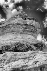 Strata (JCTopping) Tags: stone 6d 24mm redrocks clouds desert shrubs sandstone gardenofthegods colorado coloradosprings fence canon blackandwhite spire rocks manitousprings unitedstates us