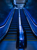 Going Blue (Steve Taylor (Photography)) Tags: architecture stairs steps blue yellow white looking up metal steel rubber light newzealand nz southisland canterbury christchurch cbd city glow perspective handrail escalator thecrossing