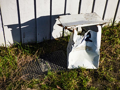 Going Postal (Steve Taylor (Photography)) Tags: postal letterbox postbox smashed broken bent damadged fence green black white metal steel wooden newzealand nz southisland canterbury christchurch northnewbrighton grass shadow distorted autumn sunny sunshine