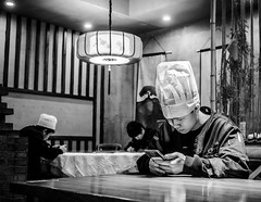 OffDuty.jpg (Klaus Ressmann) Tags: omd em1 china hangzhou klausressmann restaurant winter blackandwhite candid cook flcpeop indoor phone streetphotography unposed omdem1