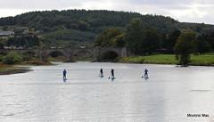 Dee River paddling surfers (mootzie) Tags: river dee aberdeen water surfers surfboards paddles wetsuits bridge scotlandwatersportsgranite blue