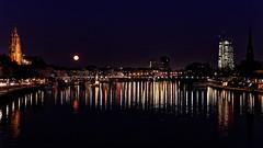 Reflections . . . (norbert.r) Tags: cityscape flickrchallengegroup frankfurt light mond moon night panorama reflection skyline spiegelung urbanskyline vollmond water river