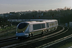 Working on third rail, Eurostar 3205 leads a morning Brussels-London Waterloo service round the curve at Tonbridge, Kent, during early February1998. (mikul44171) Tags: tmst eurostar 3205 tonbridge thirdrail kent february1998 glint