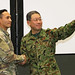 The Japan Northern Army Commanding General presents a coin to a U.S. soldier during Yama Sakura 75