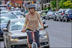 Serious Bank Street Cyclist (Dan Dewan) Tags: centretown dandewan bicycle bankstreet street people canon colour canonef7020014lusm cyclist 2017 june friday woman portrait canon7d canon7dmarkii glasses ottawa ontario lady