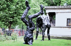 Alien (standhisround) Tags: euston church sculpture trees stpancras london england uk stpancraschurch outside alien bronze art grass