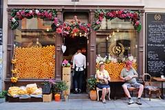 Bitter Taste (Douguerreotype) Tags: candid sverige people orange food shop sweden tourism stockholm street window city urban door