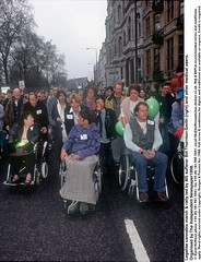 """MS sufferer leads rally 2 (hoffman) Tags: balloon banner cannabis crowd decriminalise demonstration disability disabled dope drug drugs female handicap handicapped hash lady march muscularschlerosis muscularsclerosis pot protest rally spliff vertical wheelchair woman 181112patchingsetforimagerights london uk davidhoffman davidhoffmanphotolibrary socialissues reportage stockphotos""""stock photostock photography"""" stockphotographs""""documentarywwwhoffmanphotoscom copyright"""